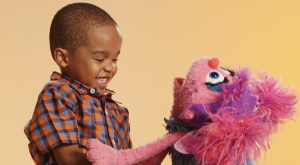 Abby and kid laughing | Sesame Street and Autism